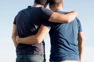 Cropped-shot-of-mature-male-couple-with-arms-around-each-other-at-coast.jpg